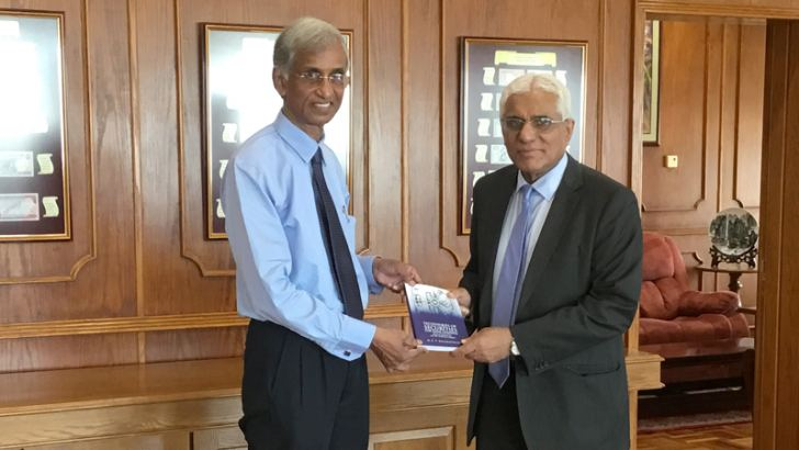 Author presenting the book to CB Governor Dr. Indrajit Coomaraswamy