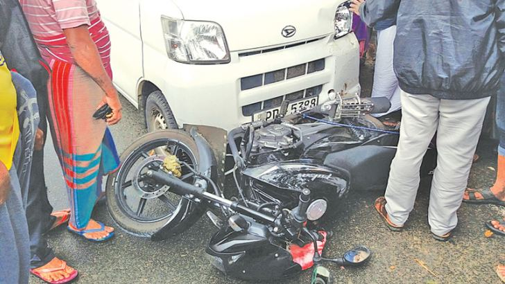 The two motorcycles knocked down by the van.