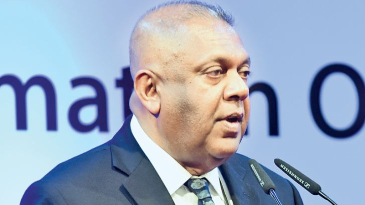 Finance and Mass Media Minister Mangala Samaraweera addressing  a workshop for Information Officers at Temple  Trees yesterday. Picture by  Wasitha Balapatabendige
