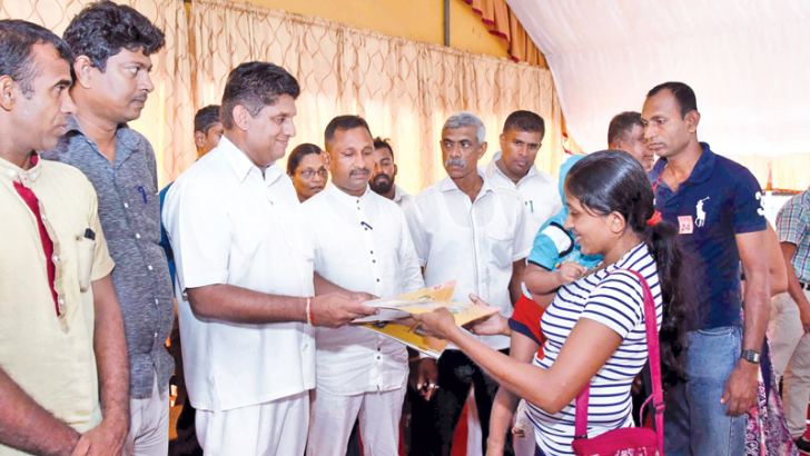 Housing and Construction Minister Sajith Premadasa distributed housing loans to 1174 low income families in the Tissamaharama Divisional Secretariat Division  to the tune of Rs. 196.5 million under the 'Visiri Niwasa'  and 'Sonduru Piyasa' housing loan schemes recently. Here Minister Premadasa is seen handing over the loan documents to a recipient.