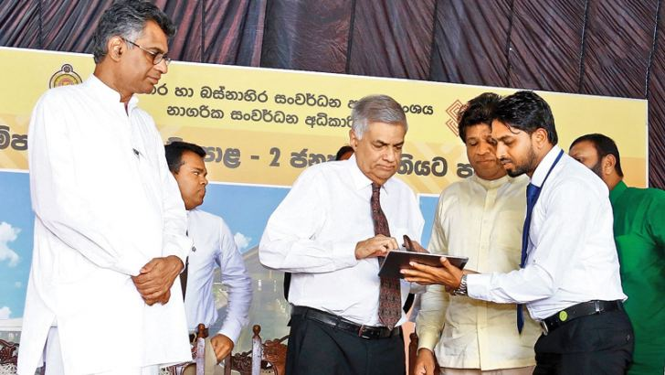 Prime Minister Ranil Wickremesinghe inaugurating the free WiFi Zone at the Gampaha Bus Stand-2. Megapolis and Western Development Minister Patali Champika Ranawaka and Gampaha district Parliamentarian Ajith Mannapperuma look on. Picture by Hirantha Gunathilake