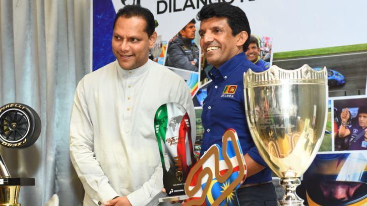 Dilantha Malagamuwa showing his Lamborghini Super Trofeo World Finals trophy to Sports Minister Dayasiri Jayasekara.