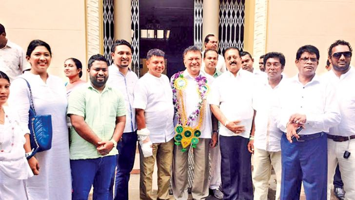 Minister Lakshman Kiriella and others leaving the Kandy Kachcheri after handing over the deposits.