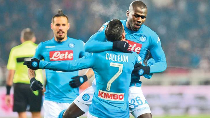 Napoli's Kalidou Koulibaly celebrates scoring their first goal with Jose Callejon.