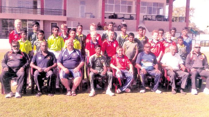 The touring under 13 cricket team from J W C International Cricket Johannesburg, South Africa played a T/20 match against Piliyandala Town Sports Cricket Academy at Bandaragama esplanade. Both teams posed for a photograph prior to the game. Seated third from left the team coach Albertus Ackerman and sixth from left the local team coach Sriyan Chaminda. Picture by Dilwin Mendis – Moratuwa Sports Special Correspondent