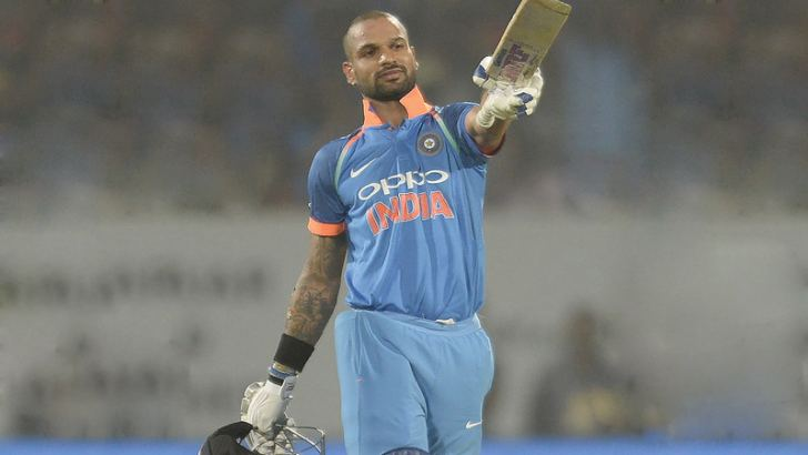 Shikhar Dhawan celebrates after completing his century  during the third ODI cricket match between India and Sri Lanka at the Dr. Y.S. Rajasekhara Reddy ACA-VDCA Cricket Stadium in Visakhapatnam on December 17. AFP