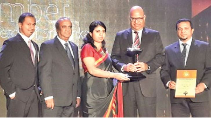 Officials from South Asia Textiles receiving the award.
