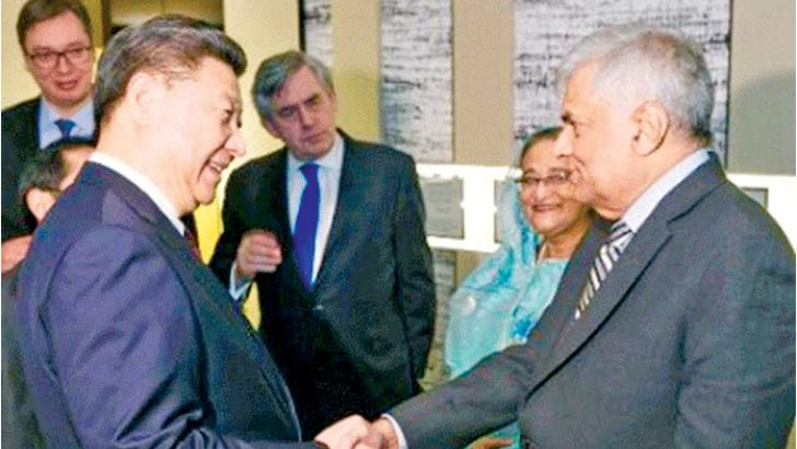 Chinese President Xi Jinping greeting Prime Minister Ranil Wickremesinghe in Davos in 2017. China is key to our future economic prosperity; managing that relationship requires skill and maturity.