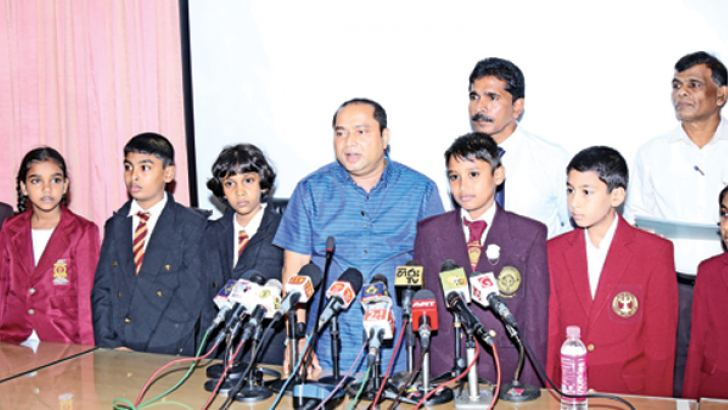 Western Province Chief Minister Isura Devapriya with students who had excelled in the Grade Five Scholarship examination in the Western Province.The students were presented with cash awards. Picture by Malan Karunaratne