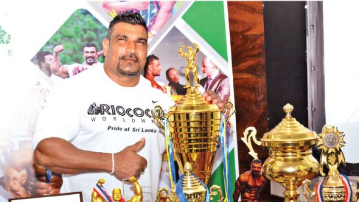 Lucion Pushparaj with his winning trophies. Picture by Sarath Peiris