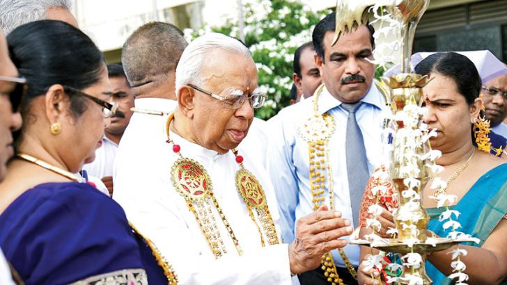 Opposition Leader R. Sampanthan lighting the lamp at the auspicious moment to mark the commencement of work of the new accident unit of the Trincomalee General Hospital.
