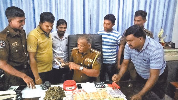 Police with the haul of cannabis and heroin. Picture by I. L. M. RIZAN, Addalaichenai Central Corr.