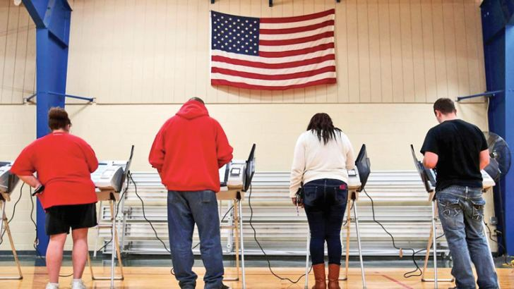 Voters cast their votes during the 2016 U.S. Presidential election.- AFP