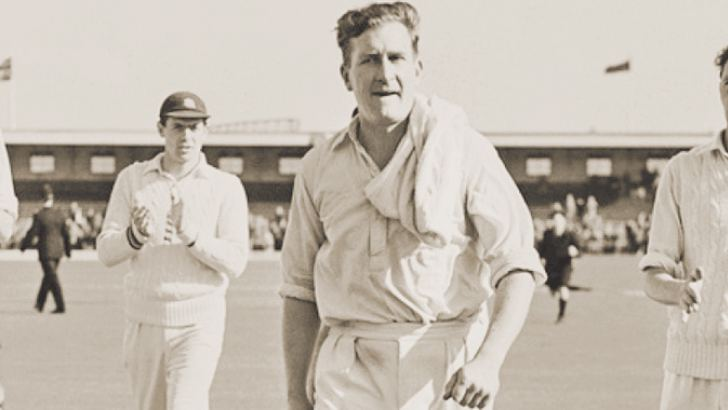 Jim Laker's incredible performance on a sticky dog of an Old Trafford pitch gave England an unassailable 2-1 lead in the Ashes series.