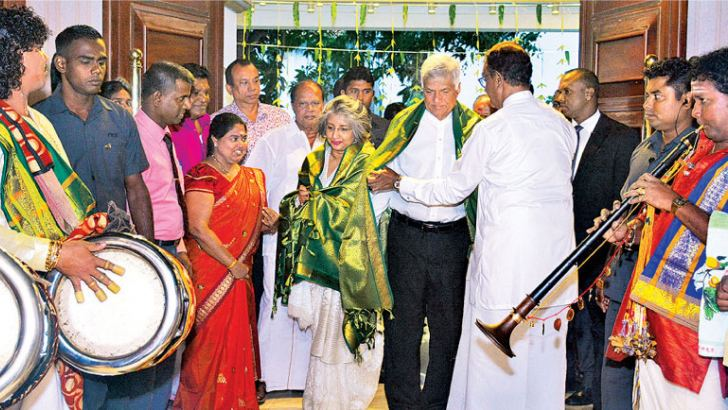 Prime Minister Ranil Wickremesinghe and Prof.Maithree Wickramasinghe being received by Prisons Reforms,Rehabilitation, Resettlement and Hindu Religious Affairs Minister D.M.Swaminathan at Temple Trees yesterday. Picture by Hirantha Gunathilake