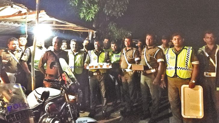 Puttalam Traffic OIC S. I. Nasheed and his team with refreshments.