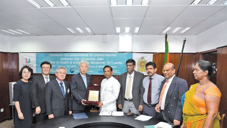 Health Minister Dr. Rajitha Senaratne with the Korean delegation after signing the agreement. Healrh Services Director General Dr. Anil Jasinghe was present..