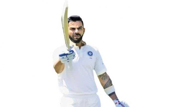 Virat Kohli celebrates scoring a century during the third day of the second Test between SA and India at Supersport cricket ground on January 15.  AFP