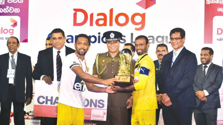 Colombo FC captain M. Rawmy Mohineed and A.A Faslur Rahuman receiving the Dialog Champions League trophy from Pujith Jayasundara (Inspector General of Police), Pradeep Keerthiratne (Vice President - National Sales, Prepaid Business & Regional Management, Dialog Axiata PLC) and Anura De Silva ( President – FFSL). Also in the picture from left -  Upali Hewage (Rtd. DIG, Vice President FFSL), I.P. Wijeratne (Director of Sports – Department of Sports Development), Thusira Malawwethantri  (Director General – Sri