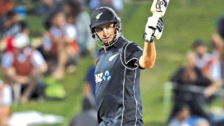 New Zealand's Colin de Grandhomme celebrates his 50 runs during the fourth one-day international cricket match against Pakistan. AFP