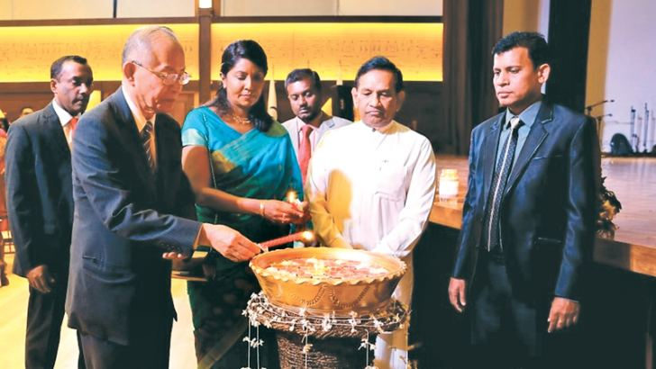 Minister Dr. Rajitha Senaratne, Minister of Health, Nutrition and Indigenous Medicine and other distinguish guests lighting the oil lamp.