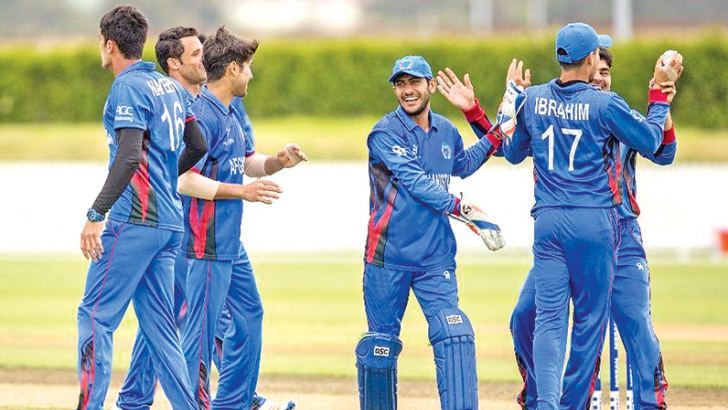 Afghanistan celebrate their 32-run win on D/L method over Sri Lanka in the Under 19 Cricket World Cup match played at Whangarei on Wednesday.