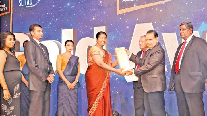 General Manager CDB, Nayanthi Kodagoda being presented the Gold Award at the SLITAD People Development Awards 2016/17.