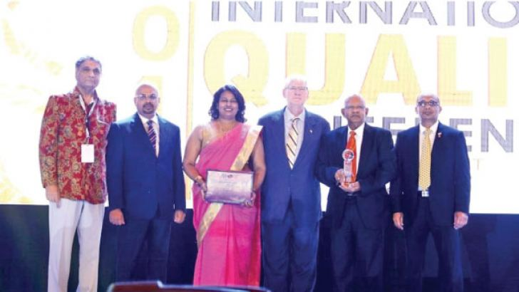Mahinda Saranapala, Director/ CEO, Kelani Cables PLC with the 'World Class Global Performance Excellence Awards'. Upul Mahanama, General Manager, Operations, Kelani Cables PLC and Shyama Perera, Manager, Technical Operations look on.