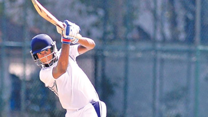 Thisuraka Akmeemana of Wesley College drives for runs during his innings of 91 against S. Thomas' College Mt Lavinia in their inter-school cricket match played at Campbell Park yesterday. Pic by Susantha Wijegunawardene