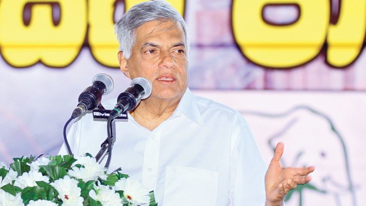 Prime Minister Ranil Wickremesinghe speaking at a UNP election rally held at Nikaweratiya town on January 21. Picture by Hirantha Gunatilleke