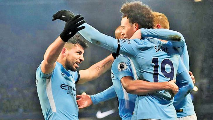 Manchester City's Sergio Aguero celebrates scoring their third goal and  completing his hat trick with team mates.