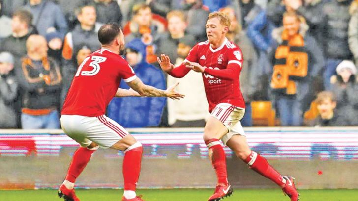 Nottingham Forest's Ben Osborn celebrates  scoring their second goal with Danny Fox.