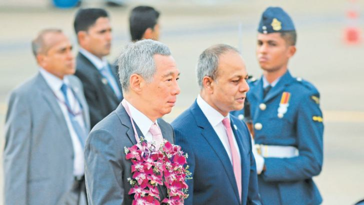 Prime Minister of Singapore Lee Hsien Loong arrived in Sri Lanka yesterday for a three day official visit at the invitation of President Maithripala Sirisena. He was received by Law & Order and Southern Development Minister Sagala Ratnayaka and Foreign Affairs Ministry officials at the Bandaranaike International Airport, Katunayake. Picture by Samantha Weerasiri
