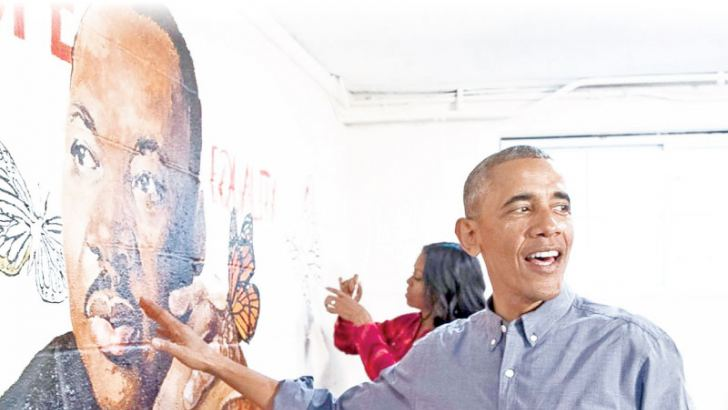 Former President Barack Obama and First Lady Michelle Obama help paint a mural depicting Martin Luther King Jr., at the Jobs Have Priority Naylor Road Family Shelter on January 16, 2017 in Washington.