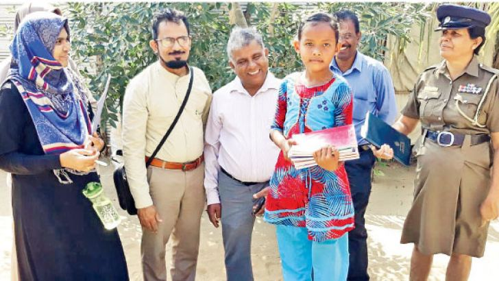 Members of the movement to re-admit school dropouts in Puttalam, with such a child. Picture by M. U. M. Sanoon, Puttalam TKN Corr.