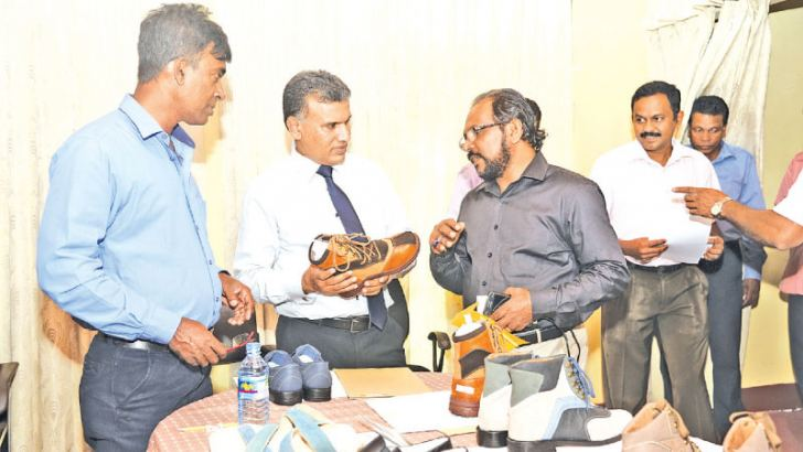 Industrial Development Board of Ceylon Director General P.L.U. Rathnamalala along with IDB Assistant Director Amaranath Wimalasinghe, in charge of the Centre for the Development of Leather Products and Footwear along with Enterprise Promotion Manager Udaya Mathugamage is in conversation with official attending the task of selecting the best competitors of leather products sent for the competition.