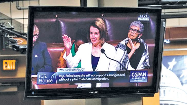 A TV shows U.S. Minority Leader Rep. Nancy Pelosi (D-CA) giving a lengthy immigration speech on the House floor during the opening press conference for the 2018 House Democratic Issues Conference on Wednesday on Capitol Hill in Washington, DC. - AFP