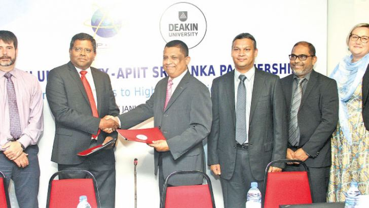 Officials of Deakin University, Australia and Asia Pacific Institute of Information Technology (APIIT) Sri Lanka exchanging the partnership agreement. Picture by Sulochana Gamage.