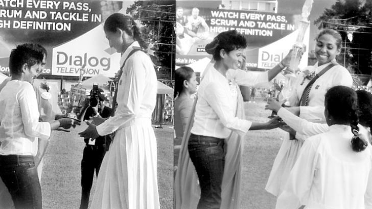 Here Koshila Amerasinghe receives Overall Champion Athlete award (on left) and Carmal House Captain receives. Overall Championship trophy from the chief guest, Ms Jayanthi Kuru-Uthumpala, the first Sri Lankan to climb the summit of Mount Everest. Rev. Sr. Deepa Fernando (partly covered). Principal of HFC is also in the picture.   (Pic by Joseph Pius – Wattala Special Correspondent)