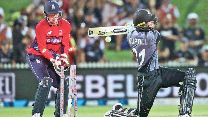 New Zealand's Martin Guptill (R) is bowled out as England's wicketkeeper Jos Buttler (L) looks on during the Twenty20 Tri Series international cricket match between New Zealand and England at Seddon Park in Hamilton on February 18. AFP