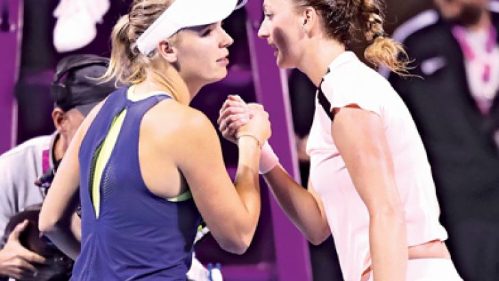 Petra Kvitova of Czech Republic (right) shakes hands with world number one Caroline Wozniacki to advance to the Qatar Open final.