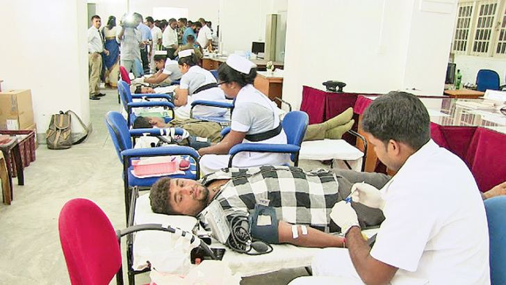 The blood donation in progress.  Pic and text  Sivam Packiyanathan, Battticaloa Special Corr.