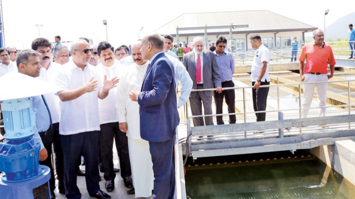 Minister Rauff Hakeem at the work site discussing present situation of the project.