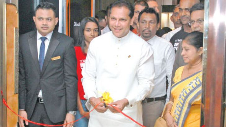 Sports Minister Dayasiri Jayasekera cuts the ribbon to inaugurate Colombo EXPO 2018 at Shangri-La Colombo, Ballroom yesterday.