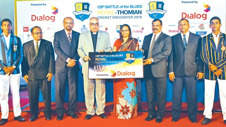 Group Chief Marketing Officer of Dialog Axiata Plc Ms. Amali Nanayakkara hands over the sponsorship cheque to Warden S Thomas' College ML Revd. Mark Billimoria and Principal Royal College B. A. Abeyratne at the media conference held in connection with the 139th Battle of the Blues between Royal and S. Thomas' at BMICH on Tuesday. Thomian skipper Delon Peiris, Ashan de Silva Joint Co-Chairman Royal College, Shyam Majeed  Group Chief Corporate Officer Dialog Axiata PLC,  S. Rajmohan Joint Co-Chairman S. Thoma