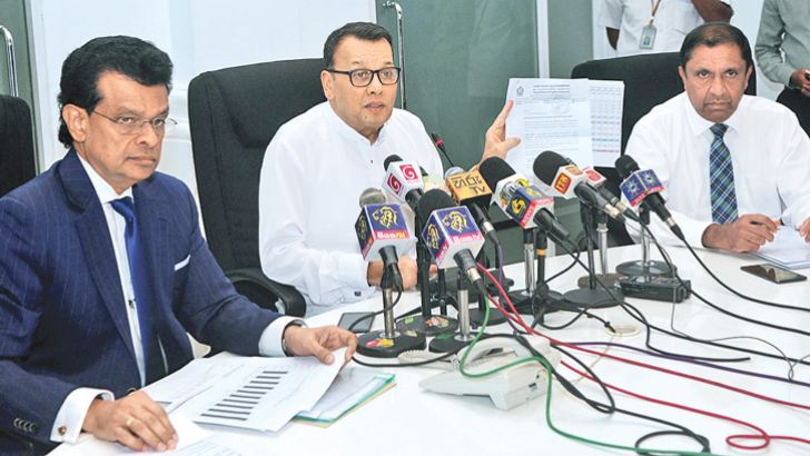 Ports and Shipping Minister Mahinda Samarasinghe speaks at the press conference yesterday. At left is Sri Lanka Ports Authority Chairman Dr Parakrama Dissanayake. Picture by Wasitha Patabendige