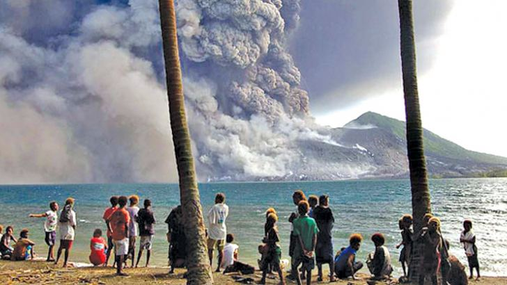 Matapit Islanders watching Mt Tavurvur volcano erupt sending ash and rocks over the already devastated city of Rabaul on New Britain Island in the wake of the volcano and quake in Papua New Guinea.