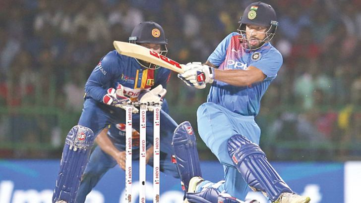 India's Shikhar Dhawan sweeps for runs during his career best knock of 90 in the first Nidahas T20 tri series match against Sri Lanka at the R Premadasa Stadium yesterday.