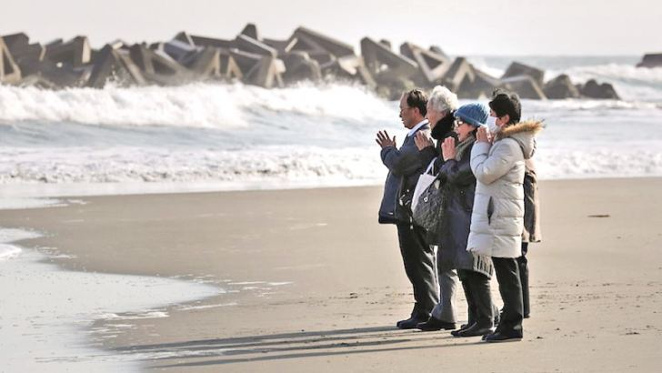 Visitors offer prayers for victims killed by tsunami at Arahama district, Miyagi Prefecture on the 7th anniversary of the 9.0-magnitude earthquake.