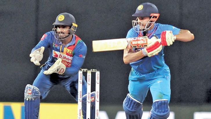 Manish Pandey gets runs on the off side during India's successful run chase.